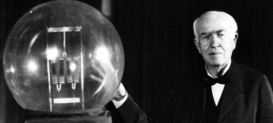 On December 31, 1879 Thomas A. Edison gave the first public demonstration of the incandescent lamp in Menlo Park. He is seen here in 1929 holding a replica of his first lamp, which had the power of 16 candles. In contrast, the lamp on the left had the power of 150,000 candles. (UPI Photo/Files)